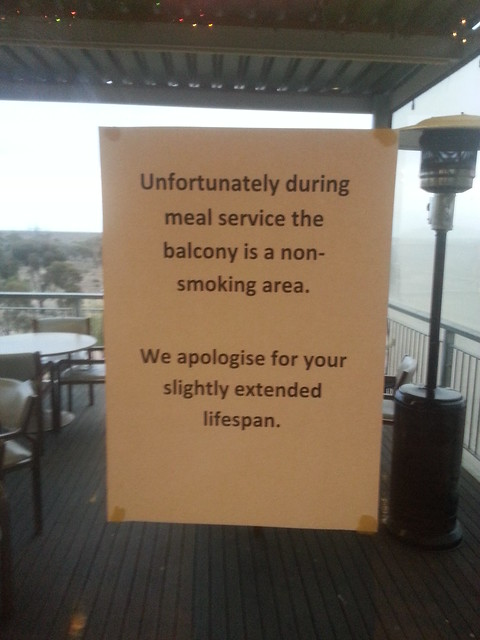 Unfortunately during meal service the balcony is a non-smoking area. We apologise for your slightly extended lifespan.
