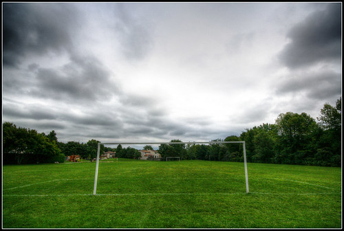 storm green field grass clouds empty soccer goals hdr ilobsterit