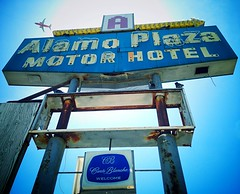 Looking up at the Alamo! (At the 1940s-era Alamo Plaza Motor Hotel, actually.) Captured several birds in this photo, including a large metal one in flight, while aiming the iPhone-cam toward the sun. :)