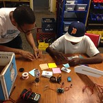 Dareno teaching Tyrese how to make a paper speaker