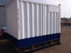 passenger car(0.0), rolling stock(0.0), shed(0.0), vehicle(1.0), shipping container(1.0), cargo(1.0),