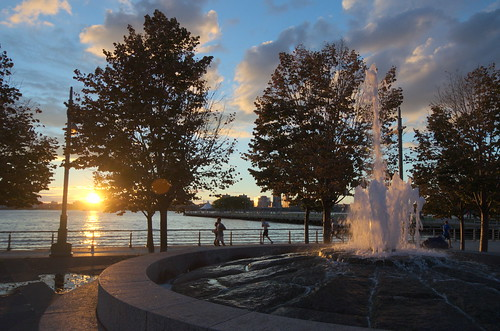 trees sunset water fountain clouds