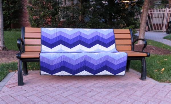 Waves quilt on a bench