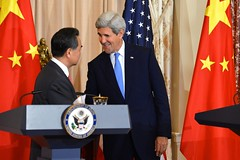 U.S. Secretary of State John Kerry and Chinese Foreign Minister Wang Yi shake hands after addressing reporters at the U.S. Department of State in Washington, D.C., on October 1, 2014. [State Department photo/ Public Domain]