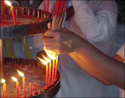 Lighting incense at Kathu shrine