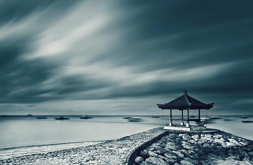 longexposure blue bali seascape beach indonesia boats island coast boat dramatic gazebo motionblur promenade shelter seashore hue cloudscape pantai nationalgeographic sanur jukung bw10stopndfilter canoneos5dmark2 canon24105mmf4lislens cemarabeach pantaicemara