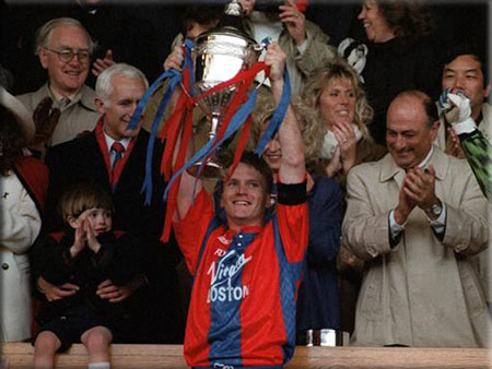 Picture of Crystal Palace player lifting trophy