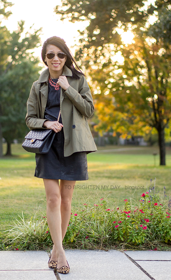 green swing trench jacket, coral necklace, black faux leather dress, leopard flats