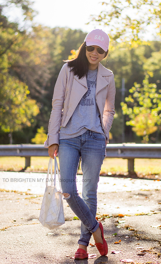 pink cap, lilac leather jacket, gray tee, distressed jeans, red loafers