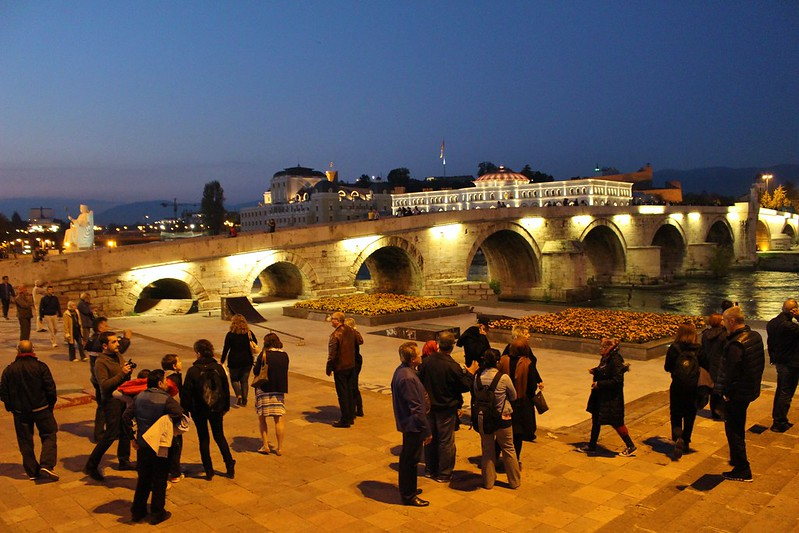 people and stone bridge