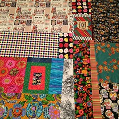 "Kind of a hot mess but 1) I wanted to use up most of these fabrics whether they ""matched perfectly"" or not and 2) it's done. #babygotquiltback  #shopyourfabricstash #sotdmakesquilts #runhardquilthard #liberatedquiltmaking"