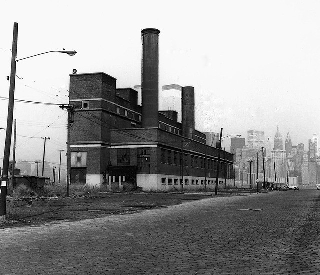 The Central Railroad of New Jersey maintenance plant at end of Johnston Avenue by the Hudson River. Like the rest of the railroad, it was abandoned in 1967. The World Trade Center towers rise up to the sky in the distance. Jersey City. March 1973