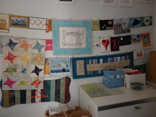 Sewing machine little quilt hanging with all my other little quilts and postcards