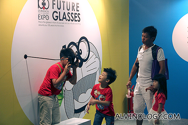 Kids playing with the 100 Doraemon glasses