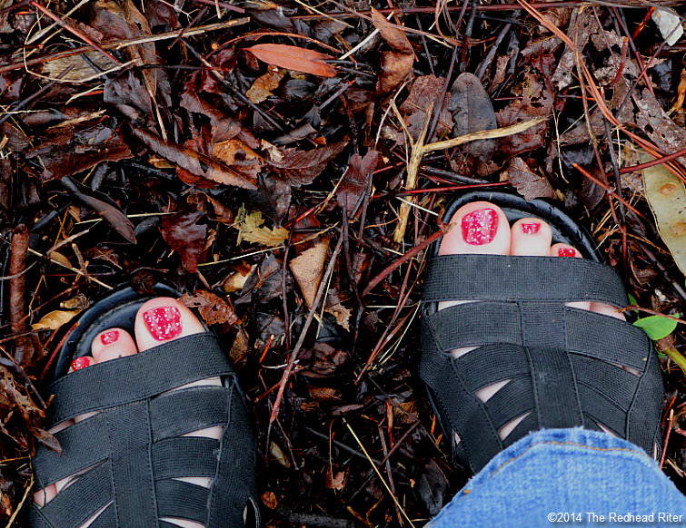 painted sparkly red toenails in black sandals