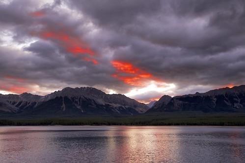 morning red orange mountains sunrise reflections purple cloudy alberta peterlougheedpark kananaskislake