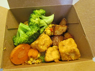 Whole Foods breakfast box - scramble, rosemary potatoes, tofu puffs, chickpea salad, steamed vegetables.