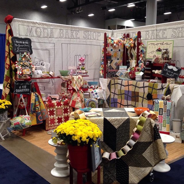 5 of my quilts playing at the AQS show with Moda Bake Shop