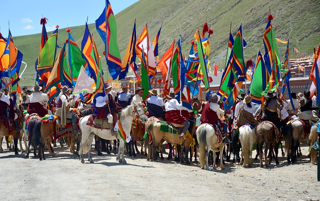 The gathering of flag bearers on horses in front of the Sershul temple, Tibet 2014