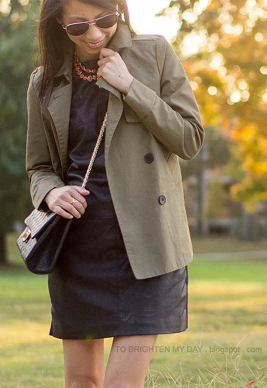 green swing trench jacket, coral necklace, black faux leather dress