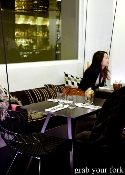 Swing bench seats at Om Nom Dessert Bar at the Adelphi Hotel, Melbourne