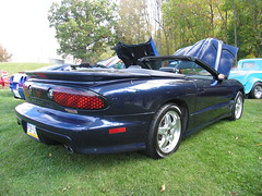 muscle car(0.0), automobile(1.0), automotive exterior(1.0), vehicle(1.0), performance car(1.0), bumper(1.0), pontiac firebird(1.0), land vehicle(1.0), convertible(1.0), sports car(1.0),