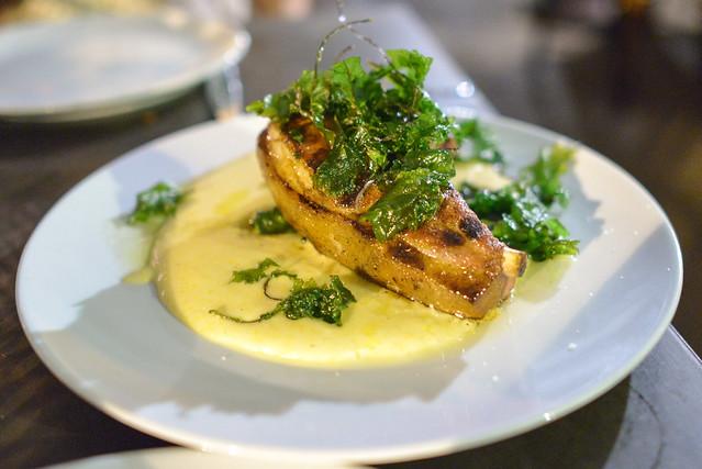 Kurobuta Pork Chop. anson mills polenta. sauteed spinach. fried baby kale.