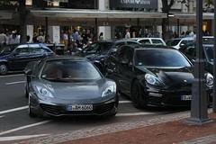 McLaren 12c Spider & a beautiful All Black Porsche Pamamera Turbo Facelift