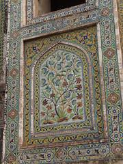 tapestry(0.0), carving(0.0), textile(0.0), prayer rug(0.0), stone carving(0.0), carpet(0.0), flooring(0.0), art(1.0), pattern(1.0), mosaic(1.0),