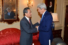 U.S. Secretary of State John Kerry greets Chinese Foreign Minister Wang Yi before their bilateral meeting at the U.S. Department of State in Washington, D.C., on October 1, 2014. [State Department photo/ Public Domain]