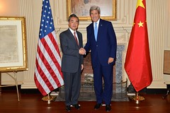 U.S. Secretary of State John Kerry and Chinese Foreign Minister Wang Yi pose for a photo before addressing reporters at the U.S. Department of State in Washington, D.C., on October 1, 2014. [State Department photo/ Public Domain]