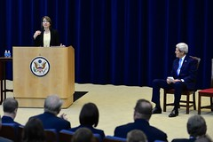 Under Secretary of State for Civilian Security, Democracy, and Human Rights Sarah Sewall introduces U.S. Secretary of State John Kerry at a Town Hall for employees in the Bureau of State for Civilian Security, Democracy, and Human Rights at the U.S. Department of State in Washington, D.C., on October 1, 2014. [State Department photo/ Public Domain]