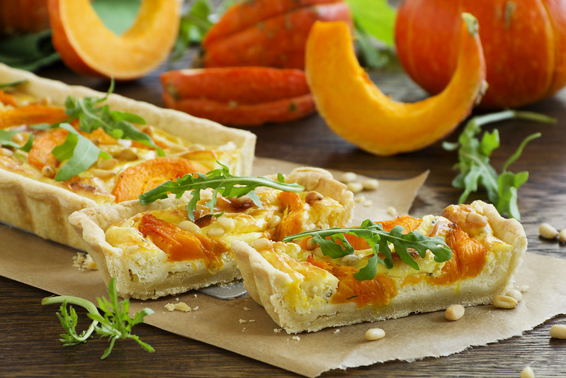 Pumpkin tart with cheese and nuts.