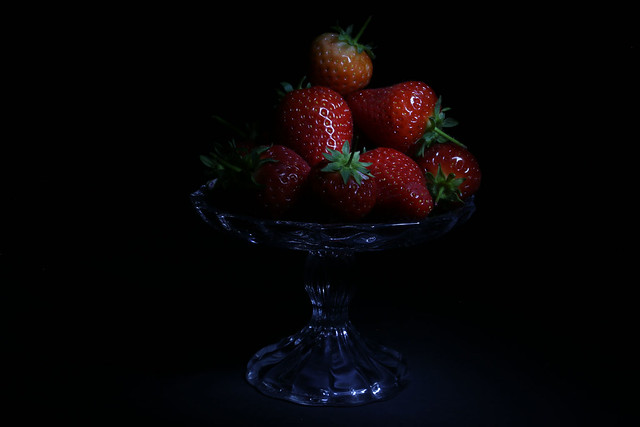 Strawberries on a glass display