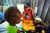Yani Mamuth, a 9-month child with severe malnutrition, looks at her reflection on a mirror at the malnutrition ward of the clinic run by the International Medical Corps (IMC) in the UN Protection of Civilians (PoC) site in Juba, South Sudan.  © Albert Gonzalez Farran, UNICEF