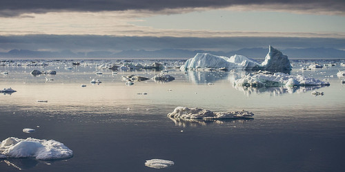 ocean mountains west ice clouds boat amazing view greenland fjord icebergs arcticcircle grönland disko greenlandic ilulissat icefjord greeland diskobay kalaallitnunaat jakobshavn ilulissaticefjord eqiglacier julienratel julienratelphotography blueju kitaa ilulissatkangerlua qaasuitsup