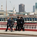 Five business people in suits passing over Blackfriars bridge in the City of London