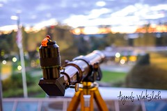 Emmet peaking thru a telescope