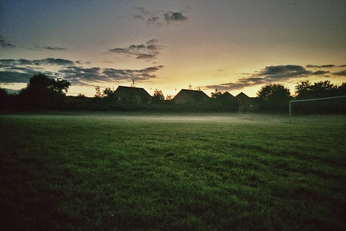 houses sky mist green field grass misty fog skyline clouds evening goal twilight low meadow layer pitch