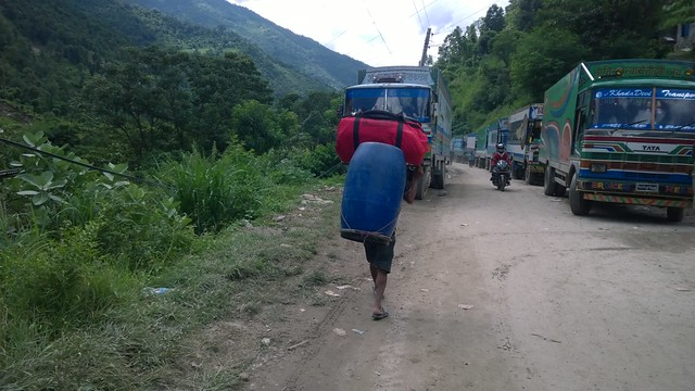 Arniko Highway landslide, truckx waiting, Porter with our gear