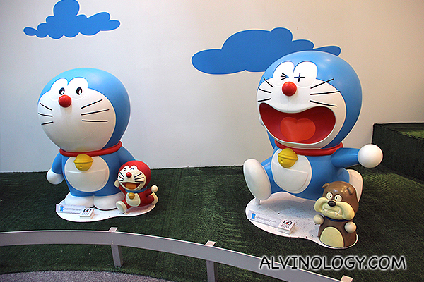 Small red Doraemon and a bulldog