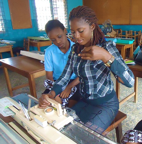 Students learning valuable skills on the knitting machine at the Mater Dei Training college in Akure