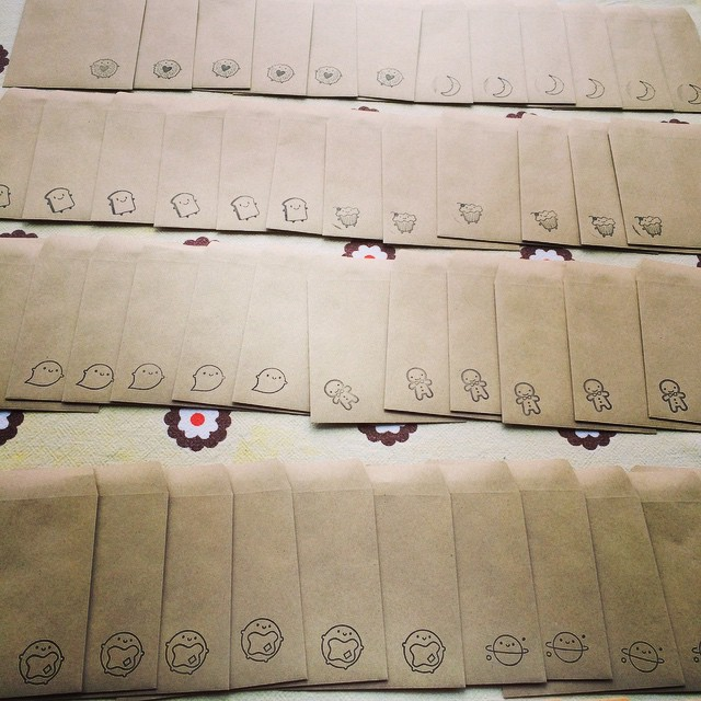 A whole table of freshly-stamped envelopes ready for your stamp, brooch and badge orders. Loving the new guys!