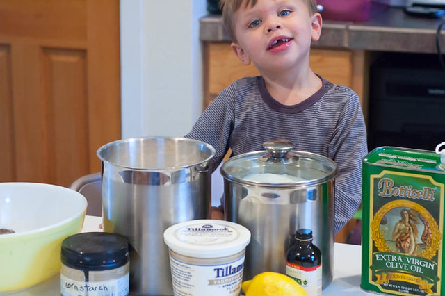 little boy making cupcakes