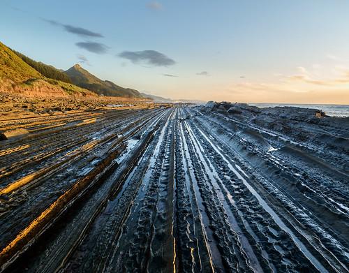 light newzealand sky beach water clouds sunrise dawn rocks tide castlepoint wairarapa