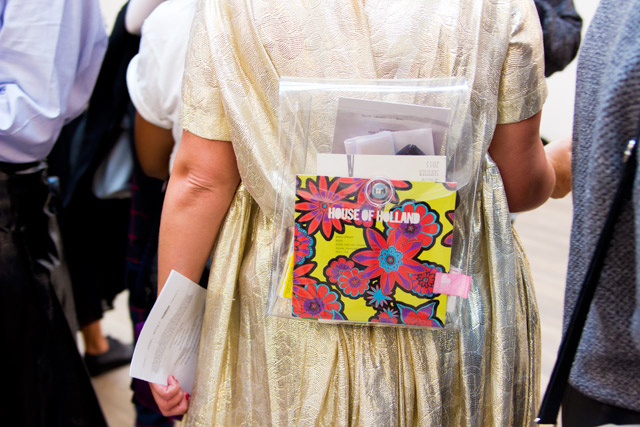 see through bag with fashion show invitations