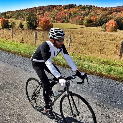 Jonathan rides past Blue Grass Valley foliage.