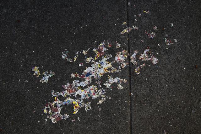 newspaper worn into the sidewalk (2010)