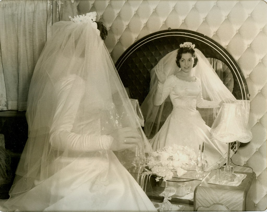 Woman on her wedding day in mirror