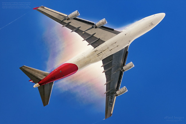 Qantas 747 VH-OJT Passing overhead with Rainbow Condensation and Contrails